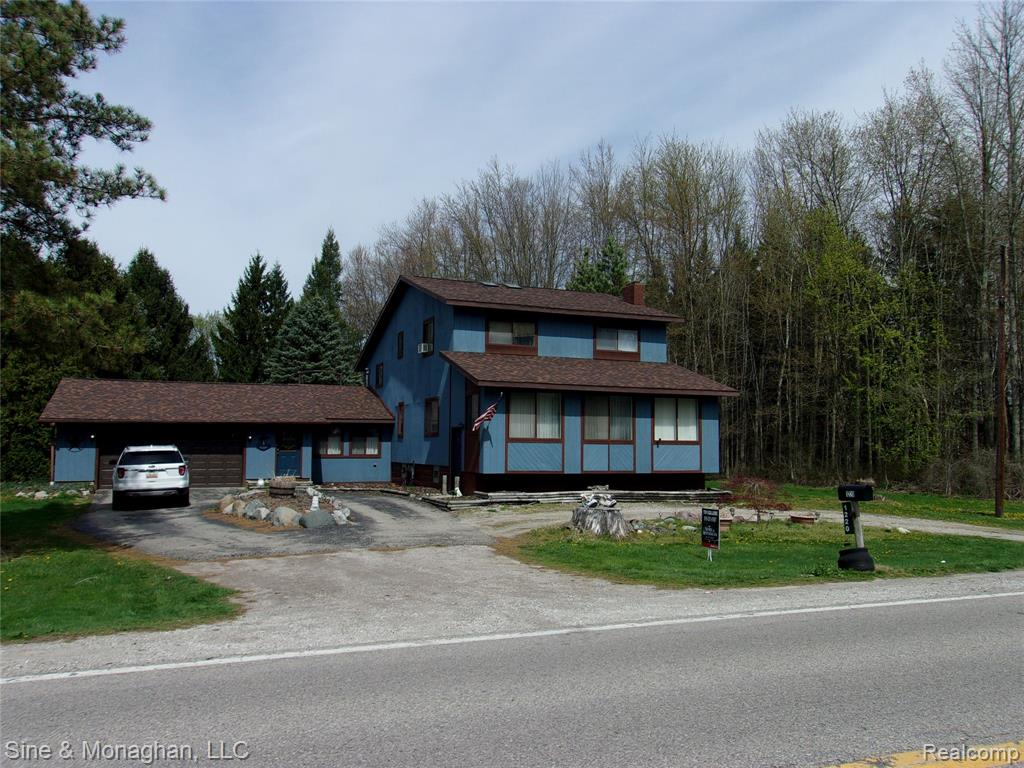 Enjoy a recreational acre on the Belle River giving a private park setting of rolling lands and deer viewed from the house up on the hill by large 3 season room, patio with built-in bon fire pit, upper master bedroom balcony and star gaze from the deck hot tub! Along with over-sized attached garage, there's the aprox 24'x43' pole barn with work shop. House sqft does not include large finished mud room and Florida room. Nice split floor plan divides master bedroom up from 3 more bedrooms up a different direction. Extra treat: indoor sauna!  Half bath houses washer and dryer laundry hook up. Newer boiler for the baseboard heat. Basement used a hobby shop.