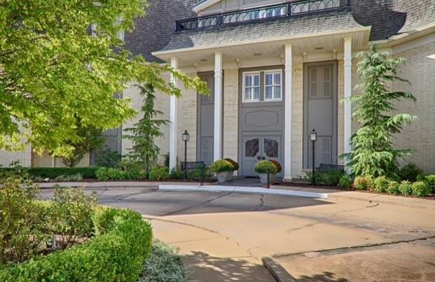 Looking for the ultimate LOCK AND LEAVE condo that has been COMPLETELY RENOVATED!!  LOOK no further Just steps from NICHOLS HILLS Plaza and overlooking the walking trails of Grand Park-You will fall in love with this second floor FLAT. ELEVATOR is just outside the door too.   The Reconfigured floor plan has an open kitchen/family room/dining room- Perfect for entertaining.  The private Owners Suite has a large walk-in closet with built in's.    New plumbing electrical and lighting.  Raised ceilings and Wood floors.  Kitchen features Viking appliances, Carrera counter-tops, large pantry and seating at the bar!  All bathrooms have been updated too. Spacious, private and secure. *Each unit has a storage closet outside of their unit and another closet by the covered parking.  NICHOLS HILLS Manor has just 11 units-Residents use an access code to enter.  Building is made completely of concrete with no shared walls.  Extremely quiet and private.