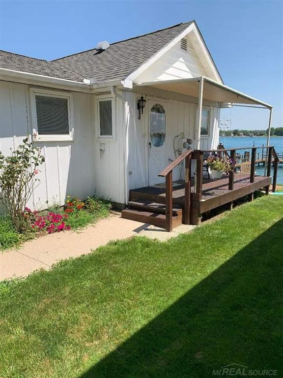 This home overlooks beautiful St. Clair River with steel seawall, and dock. watch races from back yard.  Sun-setter awnings, Hunter Douglas window treatments, Pella windows and vinyl combined. Marble sills, closets trimmed in cedar, and kitchen ceiling fan.  All appliances stay. Immediate Possession. House was updated starting back 2005 anchoring steel seawall, 2006 with roof, 2012 with new electric panel, 2014 with insulated crawl, 2016 new dock, Hot water tank and new laminated flooring in laundry room 2020. This house has room for expansion overlooking river. Just had property appraised for the Estate for $330,000 by a Certified Real Estate Appraiser.