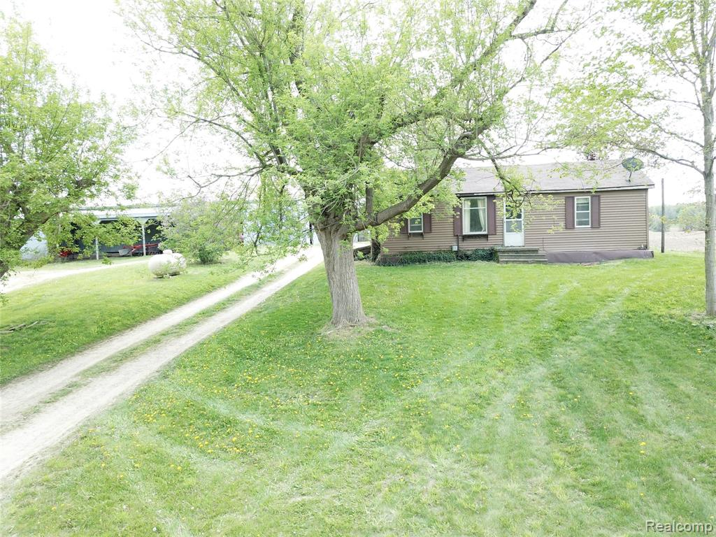 """CASH or mtg thru Greenstone Farm Credit. NO TRESPASSING; 24 HR notice for appt; TAXES on larger parcel EXCLUDES: Wind Mill; 2021 crops and rent; building rental. NO splits avail. Zoned 20 acre minimum.  Great possibilities for homestead with frontage on both Noble and Delano in Metamora Hunt area. Tin barn has several stalls for livestock w/machine storage/run-in/hay storage or large area for training arena, RV storage, etc.  House needs extensive TLC. Remodel or build your dream home on this historic country farm.  DO NOT ENTER THE PROPERTY WITHOUT A CONFIRMED APPOINT AND LISTING AGENT PRESENT--NO EXCEPTIONS.  Value is in the land and the """"tin barn"""".  Room sizes are not measured and just approximate.  BATVI"""