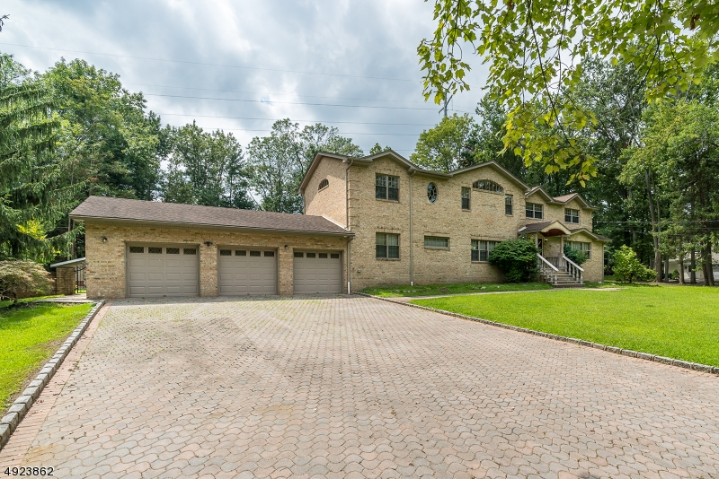 Impressive 4000+ square foot Custom Colonial home with a modern flair. Three car garage. Set on almost an acre on Dead End street in Huron Estates. The fenced backyard is an entertaining delight w/inground pool, cabana, screened gazebo, paver patios and custom barbeque.  Brand new kitchen cabinets with granite counters and stainless steel appliances.   Marble fireplace in Great Room w/wet bar.  Master bedroom retreat w/private balcony, two designer walk-in closets + huge spa-like master bath. Junior bedroom suite w/private bath.  Plus two more bedrooms and two more full bathrooms. FInished basement.  Freshly painted. Wood floors.Tile floors.Coffered ceilings. High hat lighting. Mass transit, major highways, parks, schools and shopping nearby. Move right in.
