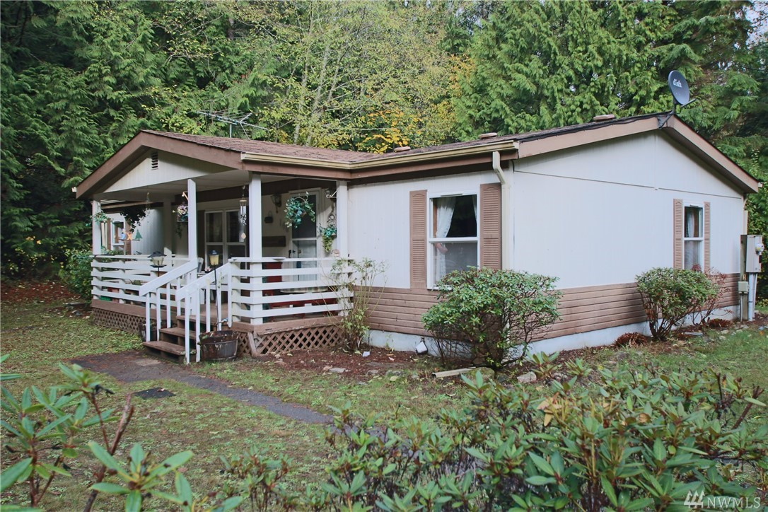 NEW ROOF COMING! Only 20 mins to Olympia! 5 acres, 3-bd / 2-bath split bedroom floor plan. Living room with vaulted ceilings, kitchen and eating nook, master w/5-pc bath and walk-in closet. Covered front and back deck - nothing but privacy all around! 2 HUGE shops (220 power) - 1 w/2-car garage, the other with single car door, finished room inside, plus full workshop and storage loft! Raised garden bed close to house, fruit trees. Close proximity to Puget Sound Boat Launches. Great opportunity!!