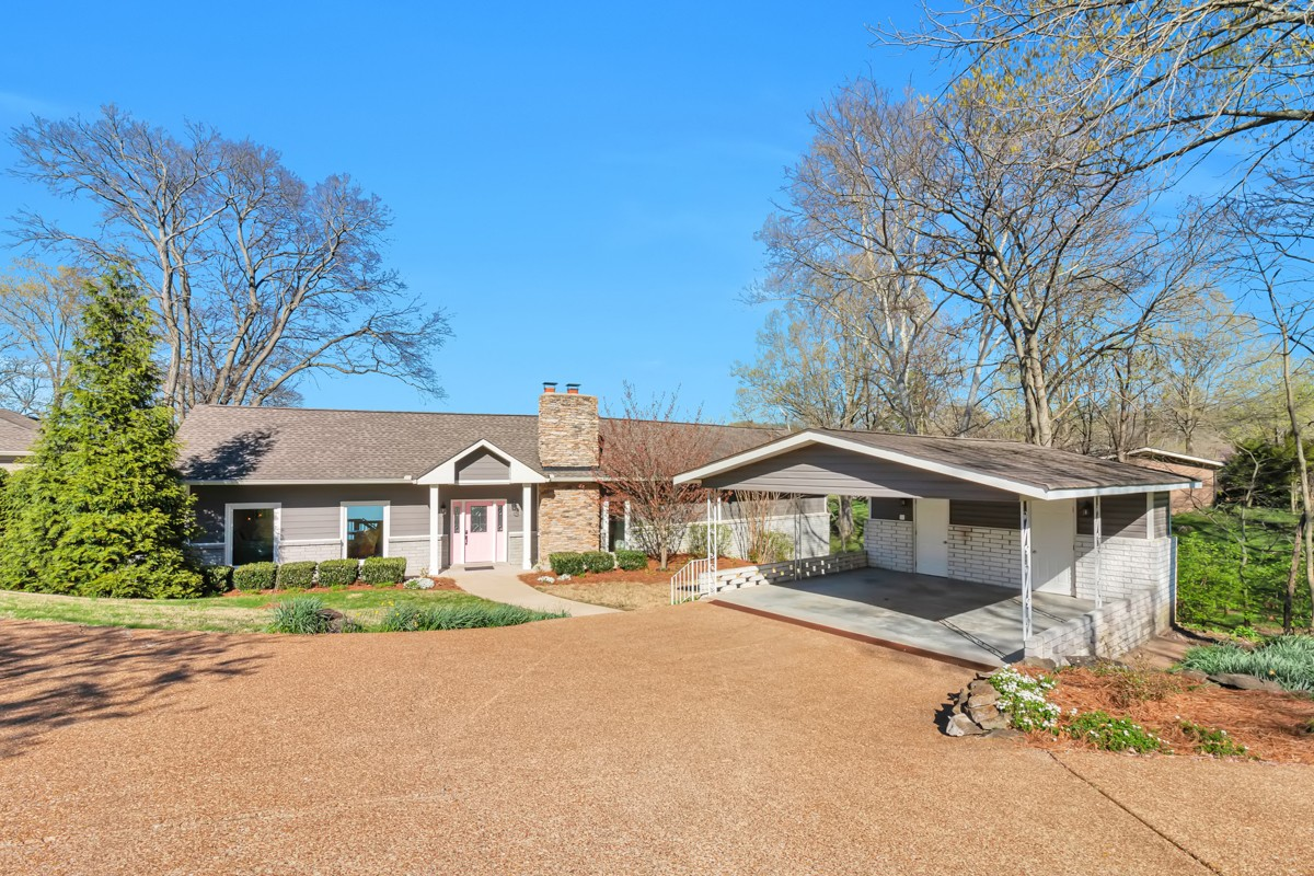 Shabby Chic meets MidCentury Modern in this one of a kind lakefront property! One acre lot on beautiful Old Hickory Lake. Private, covered boat dock!