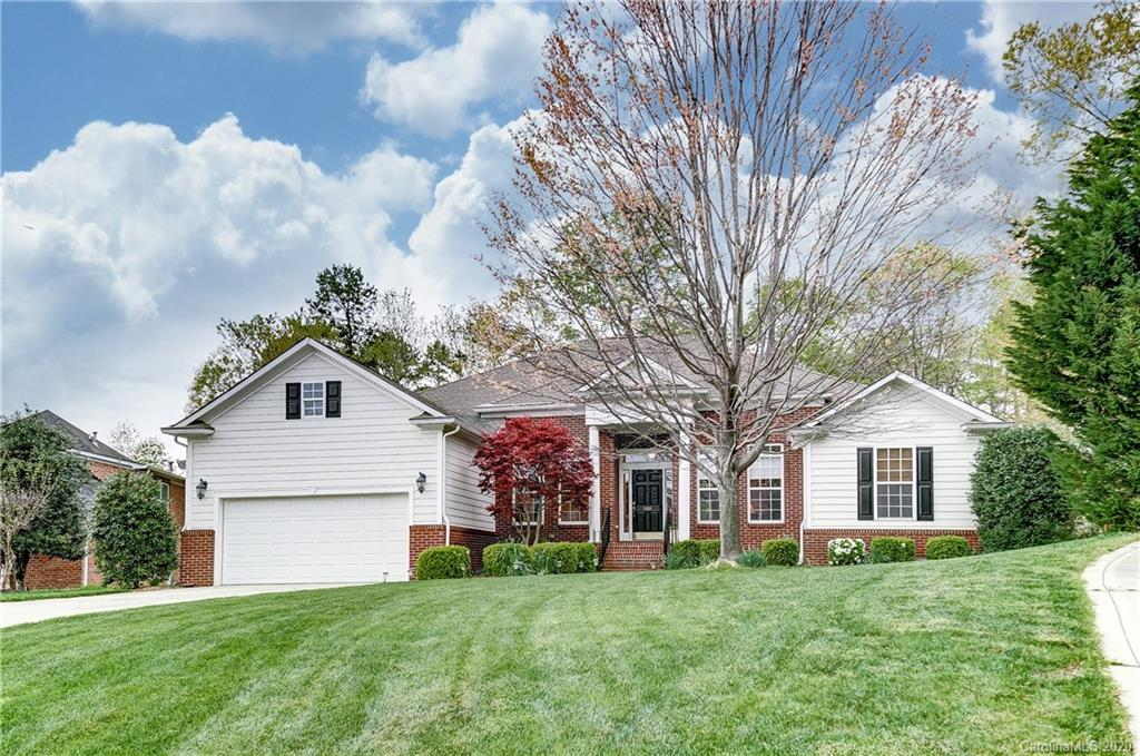 Loads of quality in 4-5 bedroom Ranch with 4 bath and vaulted 11 foot ceilings. Tray ceilings, hardwoods, jack and jill bedrooms plus guest bedroom area. Covered Porch/ deck overlooking very private treed yard. Possible dual master as bed/bonus has full bath. Lovely master suite. Lots of architectural features in very nice area of Tega Cay, on cul-de-sac. Vacation lifestyle.Brand new carpet in 3 bedrooms and bonus/bedroom.