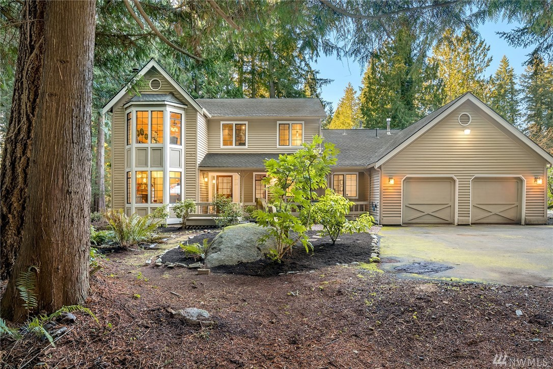 Priced Reduced!  Private Acre in heart of Union Hill! Country inspired 2-story w/covered porch, thoughtfully designed & carefully updated. Living Rm features bay window, Dining Rm opens to covered patio w/ gas fireplace. Remodeled kitchen, w/slab granite & upgraded appliances, open to Family Rm w/woodstove & deck flowing to level yard. Mainfloor guest BR w/ 3/4 bath. Oak staircase to lavish master & 2 guest BRs. Wooded lot has raised beds for gardener, inviting outdoor spaces, & easycare yard.