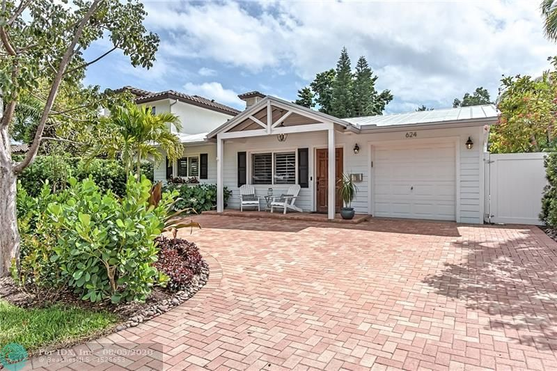 Turnkey Key West style home with a huge backyard. This house has it all, impact windows, gas range, oversized luxury refrigerator, wine cooler and metal roof. The extra deep lot gives you many options: room for a pool, addition, gazebo etc. Very clean and easy to show!