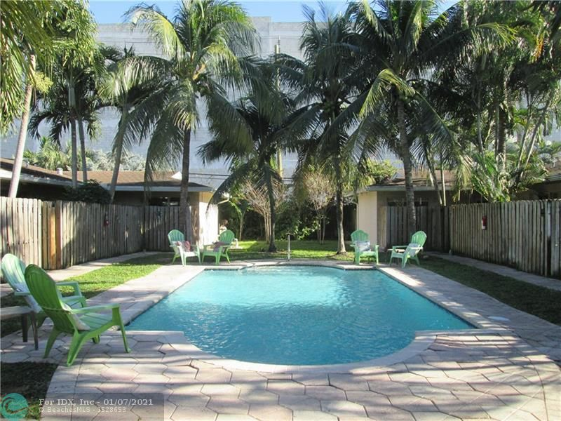 GORGEOUS AND RARELY AVAILABLE 2/2 CORNER UNIT WITH LUSH & LARGE WRAPAROUND PRIVATE BACK YARD GREAT FOR ENTERTAINING WITH PRIVATE FRONT ENTRANCE, TOO! THIS SPECIAL UNIT OFFERS HIGH END FINISHES LIKE MARBLE FLOORS, GRANITE COUNTERS, MAPLE CABINETS AND ST STEEL APPLIANCES. GREAT SPLIT FLOORPLAN PERFECT FOR ROOMATE SITUATIONS. THIS KEY WEST STYLE POOL COMPLEX OFFERS A GREAT LOCATION SECONDS TO WILTON MANORS NIGHTLIFE AND MINUTES TO SHOPPING AND THE BEACH! LAUNDRY FACILITIES ON COMPLEX AND PETS CONSIDERED! A MUST SEE!