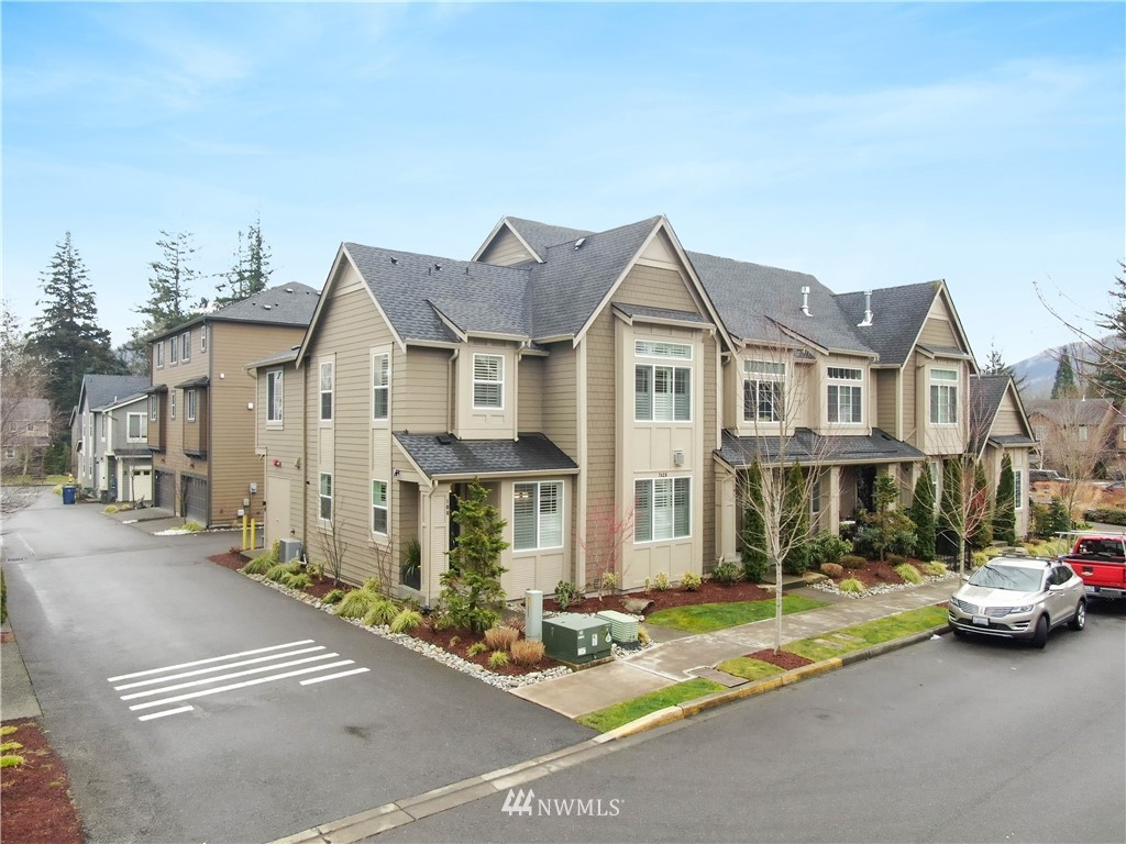 Welcome home to this immaculate 3 bedroom, 2.5 bath end unit Condo in popular Kimball Creek of Snoqualmie Ridge.Details & high end finishes thru out this home including Central A/C!Hardwood floors, Quartz countertops in kitchen w/ stainless appliances, gas fireplace in great room.Master bedroom features bathroom oasis complete w/ double sinks & spacious walk in shower.2 Car Garage alley load features professional commercial grade epoxy garage floor coating!Just a block from shops, restaurants, & close to all Snoqualmie Ridge amenities, parks & trails, plus Snoqualmie Falls & Mt Si are just outside of your backyard!Just minutes from Hwy 18 & I-90 making for great & easy commute access.  Community park too!  Snoqualmie Valley School District!