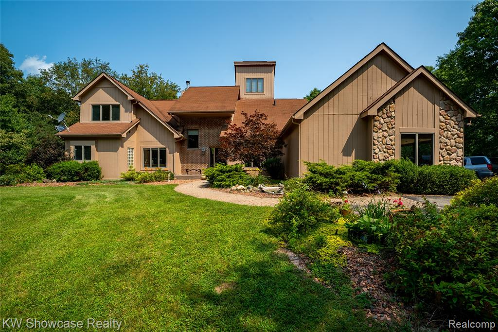 Check out the beautiful views from one of the highest points in Oakland county. This 4 bed, 2 1/2 bath home backs Up To 5,600 Acres Of Highland Rec Area with miles of trails for hiking, horseback riding and mountain biking. With ten acres you can deer hunt right in your own backyard! Unique floor plan allows for so many options off the living room- gaming room, den, sewing/craft area- the possibilities are endless! 4th bedroom has a small balcony, and a spiral staircase to a private loft and larger balcony on the third level. With nearly 10 acres, this is country living minutes from the city. Wildlife abound in the back yard-deer, turkeys and more. Several sheds on the property for storage. Come see this unique place and make it your own. All appliances stay.