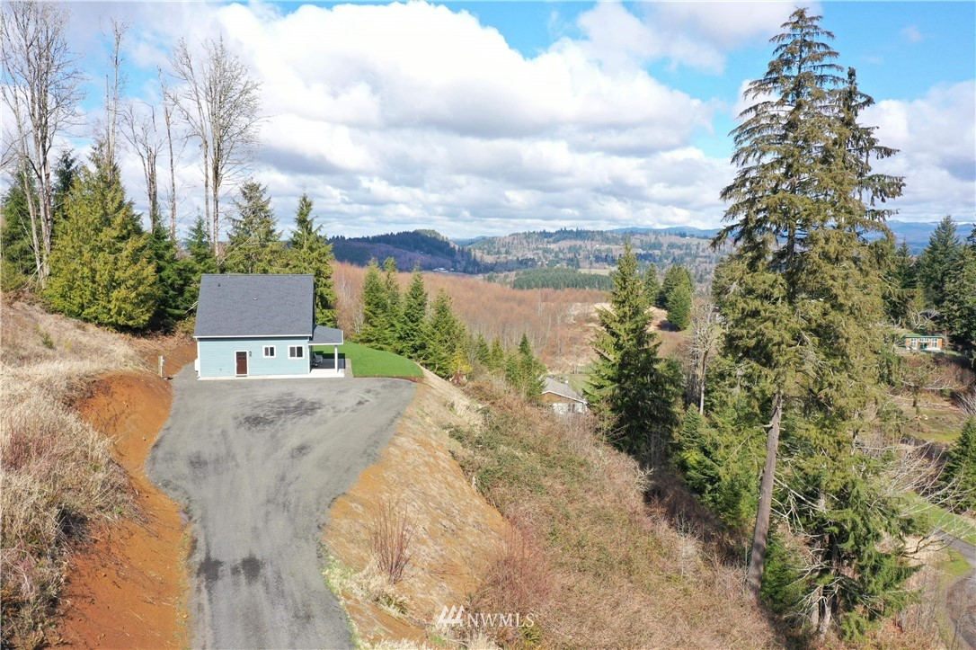 Custom built home above Lake Mayfield. Mt. Rainier and territorial views surround this private 1.25 acre lot. Low maintenance yard. This gorgeous brand new 3-bd, 2 bath home is located minutes from Mayfield Marina. Built with storage in mind, LVP flooring throughout main floor and bathrooms, custom cabinets, and quartz throughout make this home a standout in the area. Ideal as a starter, vacation, or get away home. Walk to the lake and a short drive to hiking trails. Conveniently located between Seattle and Portland. Approximate 60 min drive to White Pass Ski Resort. Air BnB potential.