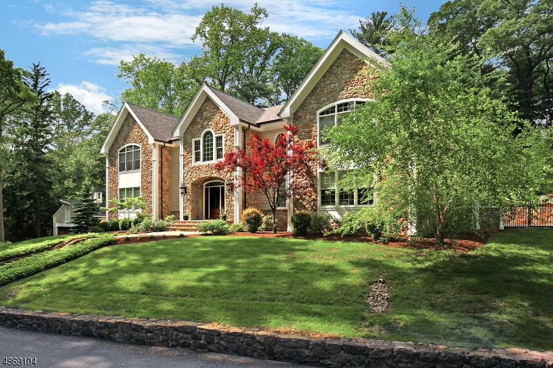 Built in 2011 and extensively enhanced since, this visually striking home is customized throughout its three finished levels. Ideal for those looking for something other than the local/traditional norm, it's a touch of California on historic Bernardsville Mountain. Impressive two-story living and dining rooms with floor to ceiling stone fireplace, coffered ceiling & dramatic wall of windows. Superb kitchen w/custom white cabinetry, marble countertops, cherry island & breakfast bay. First floor master suite w/boutique style walk-in closet and master bath w/Carrera marble, jetted tub & oversized shower. Four additional en-suite bedrooms. Finished lower level w/billiards room, kitchenette, wine and exercise rooms. Built-in generator.