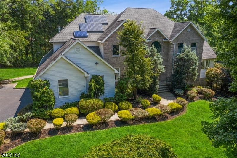 Thinking of moving to the suburbs to enjoy privacy, comfort and plenty of storage space? This is it! As you drive up to this stately manor, the first thing you will notice is the privacy a long driveway provides guiding you to a large stately home with 4420 generous square feet of living space and an additional approximate 2000 square feet of full finished walk-out basement space! This home features a first floor bedroom with bathroom and large closets. An additional 4 Generously sized Bedrooms and 3 full bathrooms can be found upstairs. The kitchen opens to the rear yard providing abundant light and nature views while enjoying meals. Kitchen also features a large pantry and eat-in area. Priced to sell!