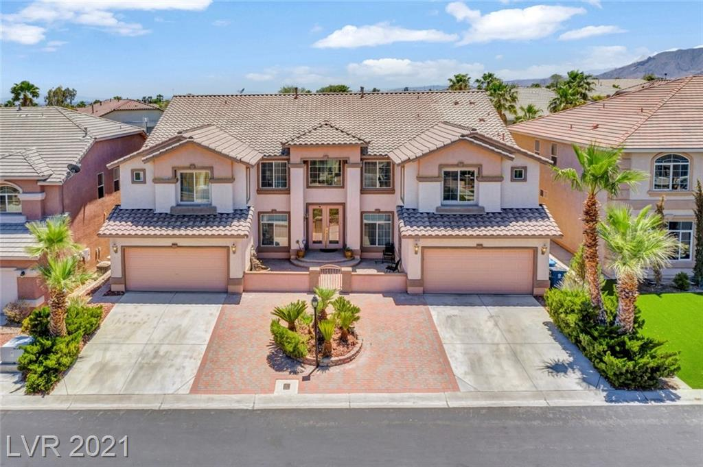 Extraordinary & Rare 6 Bed, 5 bth home w over 6200sq feet, 4 car garage w/ 2 entries to the house, 2 mastersuites, pool/spa w/ additional sunroom located in gated Ironwood estates in Northwest. Home features a stunning entryway w/towering ceilings, Separate sunken formal dining & living area, 3 elaborate staircases in which one leads to the private Mastersuite upstairs that includes a fireplace, Large private balcony overlooking the beautiful pool/spa, sitting area, Very Spacious walk in closet w/ plenty of built in cabinets for extra storage, his & hers bthrms, separate shower & large jetted tub. Huge oversized loft & 4 more large bedrooms, one that has it's own bthrm w/a walk-in closet. 2 laundry rooms, one on each level. Downstairs Master additional sunroom added, leads to backyard & pool. Kitchen has plenty of cabinets, granite counters, walk in pantry, dbl ovens, Marble flooring through out. Entertainers dream home w/ All appliances included & front fountain in courtyard area.