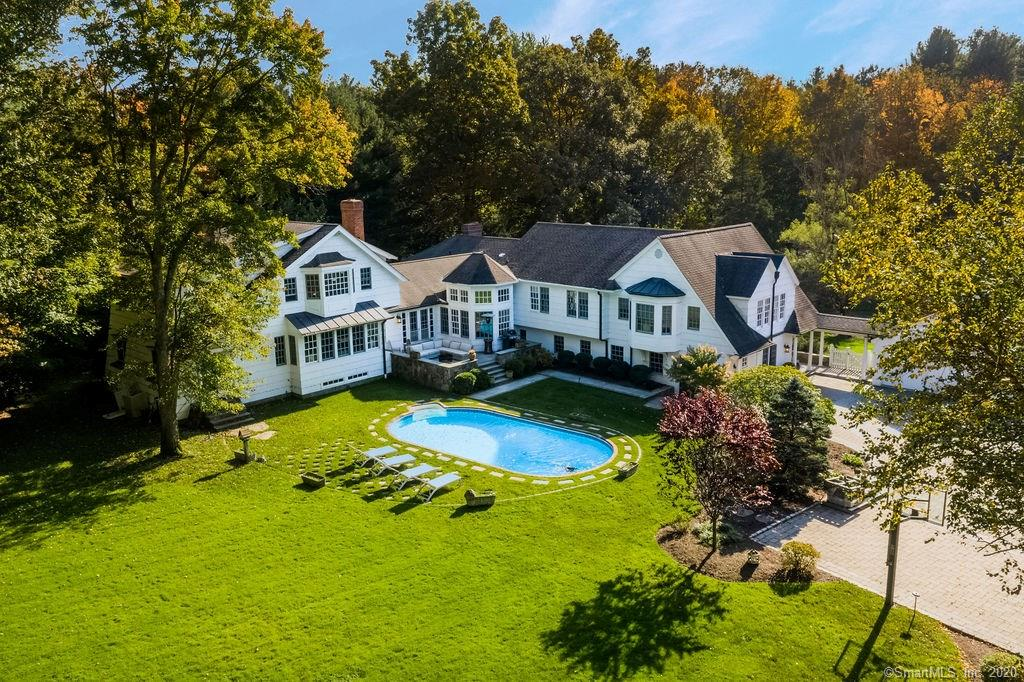 Spend the Summer in this one of a kind stunning home just over the Westport line! Wonderful inviting home that says kick off your shoes & stay awhile! Get comfy in the family rm w/ fpl - watch a movie on the drop down screen or cozy up in a chair to read a book - pick a room! Is baking one of your delights? There's a baking kitchen!! Each room is as pretty as the next! Architecturally designed for a growing family w/ room for all ages! The beautiful craftsmanship shows throughout;detailed moldings, recessed nooks, windows seats, high ceilings, coiffured ceilings & many built ins + closets galore! Walk down the covered breezeway to the towered entrance foyer w/ handpainted walls, there's perfect size LR w/ fpl, exquisite dining rm w/ decorative niches, 2 YES 2 kitchens-the one for BAKING of course! A circular windowed eating area , great room w/fpl off the kitchen leading to a raised patio overlooking the lush, flat backyard w/ inground pool. An absolutely GORGEOUS Master Wing w/ sitting area +  fpl, upstairs office, A 5 family bedroom wing w/ 3 full baths, guest suite w/a full bath, AMAZING laundry rm & a gym. There's 2 mudrooms; one w/ built-ins,  a cedar closet & another mudroom w/ full bath to service pool + lower level family room ! An envious flat backyard w/pond that is stocked w/ Coy fish!  SO much to LOVE about this home  - it just brings people together! A home to truly entertain family & friends! AND ....you'll love the perfect lower Weston location!
