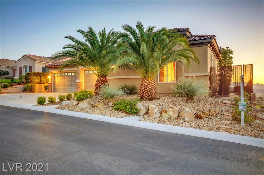 MILLION DOLLAR VIEWS of LAS VEGAS City Lights, REVERE GOLF COURSE, WEST MOUNTAINS, SPECTACULAR SUNSETS! Perched above the sprawling Revere golf course you gaze out over your Infinity Edge Solar Heated Pool w Raised Waterfall Spa. Additional owned Solar System for home. Kool Deck Patio w elevated seating area. Remote patio screens w wind sensor allow you a covered seating lanai to sit and enjoy the views.  The attached 350 ft Casita has full bath/mini Kitchen and creates a charming Custom GATED courtyard! The Great Room has built-ins, fireplace, wet bar, exquisite crown molding!  Kitchen has granite, walk-in pantry custom cabinets/pullouts. 2yr new water heater, dual 2 yr new air cond units, full house water osmosis, 300 gallon storage tank for filtered water, commercial grade garbage disposal, new microwave, tile floors in the living areas, laundry room w sink/storage, Central Vac. Original owner. Walkable to Revere Golf Club, Buckman's Restaurant, and the Sun City Anthem Center!