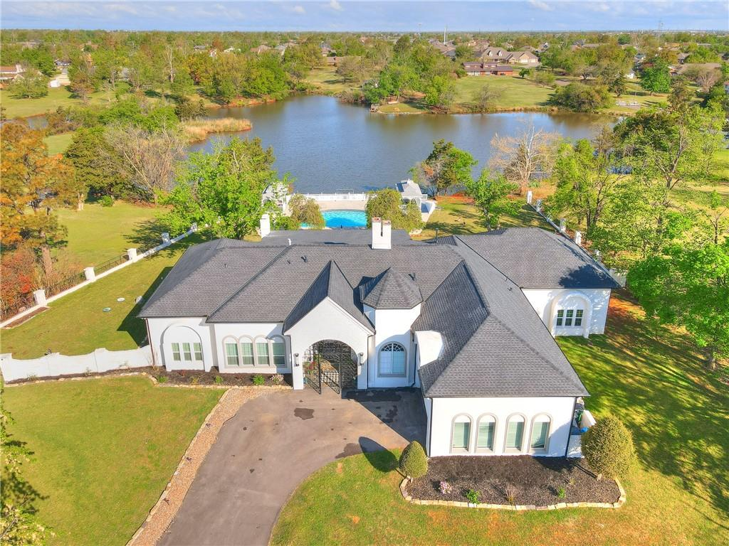 Captivating lakeside estate offers 6 bds,7.5 baths on a 1.18-acres!!Resort-like property tucked away in OKC will amaze you.Amenities include in-ground pool,2 cabanas,magnificent outdoor entertainment area, NEW dock/ lake access.Soaring ceilings,arched doorways,french doors,custom windows,eclectic light fixtures.Gourmet eat-in,island kitchen has professional stainless steel appliances includes 8 burner gas range & double ovens.Flexible floor plan w/2 lavish living areas,2 dining & 3 indoor fireplaces!Master suite offers his/her vanities, free-standing tub, custom tile/stone shower & walk-in closet.Guest rooms, include a second master suite.Upstairs APARTMENT w/partial kitchen and full bath.Great for teenagers, guests or home office!An extraordinary patio and fireplace set the stage for great outdoor celebrations or quiet retreat. Recently renovated pool/spa. Lake view cabanas!Updates include,electric,plumbing,sprinkler system, guttering,2 new HVAC units,several washer and dryer hookups.