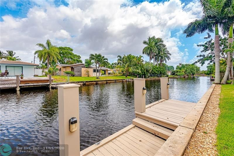 This gorgeous waterfront home with ocean access has a gorgeous open floor plan with a ton of natural light. Kick back and enjoy canal views from almost every brand new impact windows & slidding door in the home, Located at the end of quiet Cul de Sac, Large lot with large back yard on waterfront, Open canal views and dock, Large screened in back porch, freshly painted inside and outside, great views of waterfront from living room and kitchen area, Kitchen has pass through windows to porch, Good Size bedrooms, Make yourself at home in this spectacular spac, relaxing times entertaining friends & family on your private screened porch overlooking the water. PRIVATE BOAT DOCK, Very convenient location to shopping, nightlife and highways. A MUST SEE!!