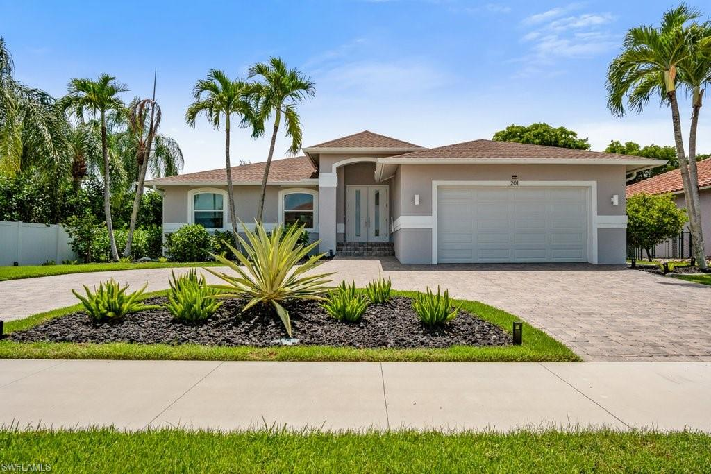 This fully remodeled and updated stunning Marco Island home is located on a quiet street in a very desirable neighborhood! Light, bright and airy 1,549 square feet with 3 bedrooms, 2 full bathrooms, and 2 car garage.  The custom sliding door opens up the entire family room wall into the huge screened lanai with outdoor kitchen adding tons of space for outdoor gatherings or lounging by the oversized pool and spa!  All new impact resistant windows and doors throughout. The eat in kitchen features a breakfast bar, quartz countertops, upgraded lighted cabinets, tile backsplash, lots of storage, and pull out shelves. Brand New Whole House Generator installed in 2021. All New Roof, A/C with UV, Screened Pool Enclosure, Windows & Doors were all installed in 2017.  Marco Island is surrounded by incredible white sand beaches, excellent fishing, and the most breathtaking sunsets in the world!