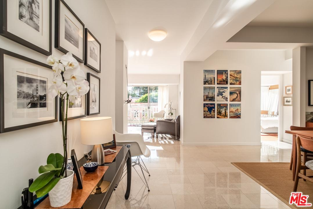 A rare opportunity to own in West Hollywood's most sought after full-service building. Echoing the building's mid-century modern aesthetic, this exceptionally bright and airy west-facing unit features an expansive open floor plan among the largest 1 bedrooms in the building with double balcony and high ceilings. A luxurious suite of building amenities enhances the living experience, including a saltwater pool, spa, sauna, newly renovated fitness center, 24-hour doorman and security team, along with complimentary valet parking for your guests. Steps from the famed Sunset Strip, you can enjoy unlimited access to LA's famous nightlife, dining, and shopping scenes. With so many exciting new developments in the area, home values are projected to continue rising.