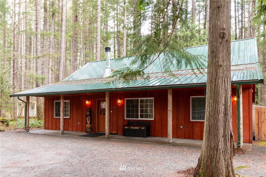 The PERFECT investment property is finally available in Packwood! Very well maintained three bedroom, two bathroom home on an energy efficient concrete slab. This property is turn key and fully furnished. The beautiful furniture, brand new appliances, the hot tub on the back porch, even the BBQ stays. Have you wanted your own vacation spot near White Pass and thought about renting while you are not there? This is it. Solid rental history from the 5 star Superhost. This property connects to thousands of acres of National Forest, Plus, there are trails right from the back yard to the Cowlitz River. This won't be on the market long.