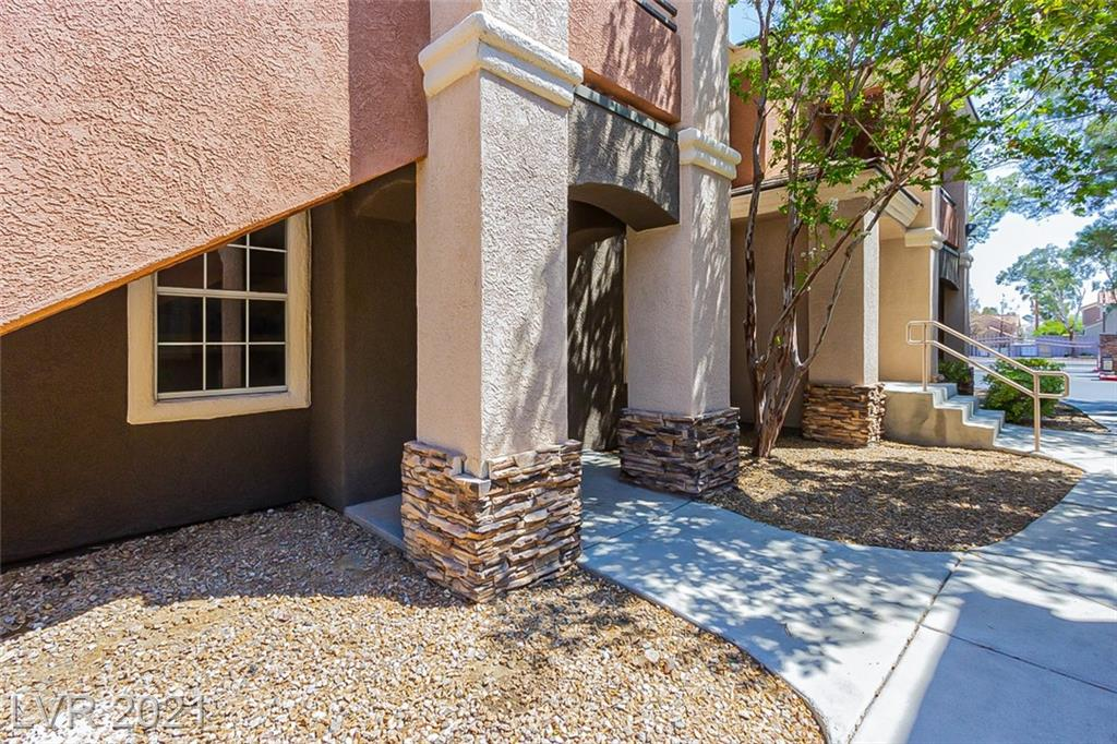 This Las Vegas one-story home offers a one-car garage. This home has been virtually staged to illustrate its potential.