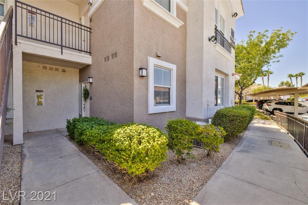 LOCATION, LOCATION, LOCATION!!! Highly upgraded 2 bedroom, 2 bathroom ground floor condo, conveniently located in the heart of Green Valley, 10 minutes from the airport & 15 minutes to the Las Vegas Strip! Interior features a bright and open floor plan with 2 tone paint, UPGRADED kitchen with NEW quartz counters, NEW stainless steel appliances, & NEW tile back splash! Large family room area with built in shelving and fireplace. Designer chandeliers in family and dining room! Covered patio area conveniently located off of dining area, with primary bedroom access! Huge primary bedroom with ceiling fan, primary bath with tub, shower, and spacious walk-in closet! Good size secondary bedroom and bath. NEW elevated and upgraded fixtures throughout! Close walk to community pool/spa! MUST SEE!