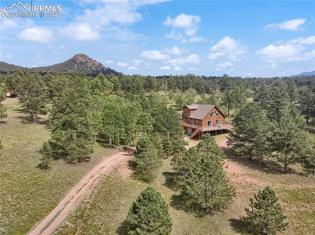 Stunning mountain property with plenty of space. Walk-out basement with large family room, full bathroom and two bedrooms. Main level has large great room, vaulted ceilings, full bath, bedroom and large maintenance free wrap around deck to take in the Colorado Views. Upper level loft has enough room for Master bedroom and sitting area, full bath and walk-in closet. Tandum Garage with room for 2 cars, and storage.