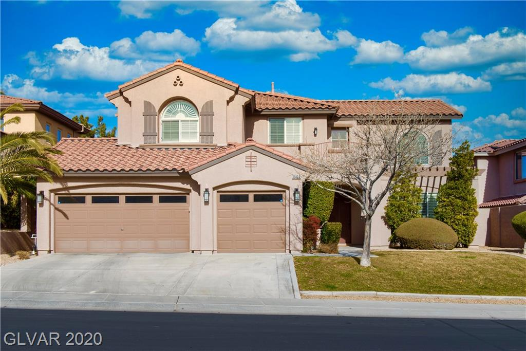 A Two-Story, 3 car garage beauty, in gated community in the Vistas in Summerlin. This home features 4 bedrooms, 3.5 baths, w/a downstairs den/office and upstairs loft w/balcony.  It's dramatic vaulted ceiling entrance, meets you w/a wrap around staircase. Pool/Spa, w/sun deck, built in bbq grill, patio w/sun shades. Great open concept kitchen, w/island, granite counter tops, gas range, double ovens. Conveniently located, near 215 & DTS. Must See!