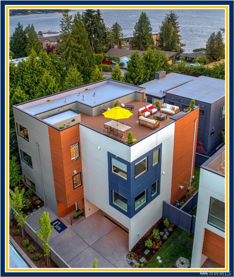 """BDR Homes presents a fresh new modern view home located steps from Houghton Beach Park & Carillon Point. Expansive roof-top entertainment terrace w/sweeping Lake Washington, Olympics, & Seattle skyline views. Chef's kitchen w/ gourmet island & professional grade appliances. Covered outdoor room w/heaters. 4 bed + den & bonus room. Luxurious master suite w/two walk-in closets. Built by the BDR Team, 3-time winner of the coveted Builder of the Year Award & 425 Magazine's 2018 & 2019 """"Best Builder"""""""