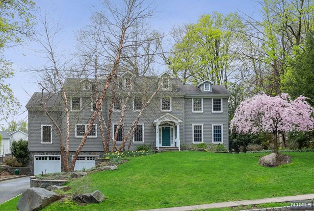 Built in 2005 by the owner on one of Tenafly's most desired streets.This house features 5 very large bedrooms, A large master suite, high ceilings, hardwood floors  carpets and tiled floors,, multiple heating and cooling zones including radiant heated floors in the kitchen/breakfast area and master bathroom. A huge chef's kitchen with top appliances. Additional features include an off the kitchen study, pantry and laundry room. a large finished basement with a br and a fbth, a full house generator and a ton of closet space. This is an absolutely amazing home, an abundance of large windows, an amazing street and location.