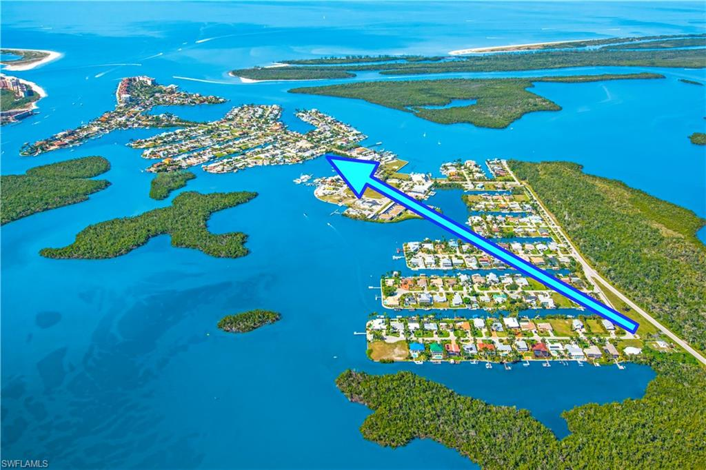 Rare opportunity to own two lots side by side. Located on Tarpon Bay, on the Beautiful Isles of Capri. Situated in the middle of 2 lots, this property features deep water with quick, Direct-access to the Gulf of Mexico. You can live in one of the units and rent the rest out, or tear it down and build your dream home. Three driveways with plenty of extra parking for your boat trailer or RV. This property is listed for Lot Value. Isles of Capri is a tropical island that boasts an abundance of wildlife, four great restaurants & three marinas. Located one mile from Marco Island & only 20 minutes away from Downtown Naples with its sophisticated shopping & five star dining. Our area is famous for its white sand beaches, world class fishing, boating & fantastic golfing. Capri is the perfect place to sit back, relax, unwind & let the sights, sounds & smells sooth your mind, body and soul.