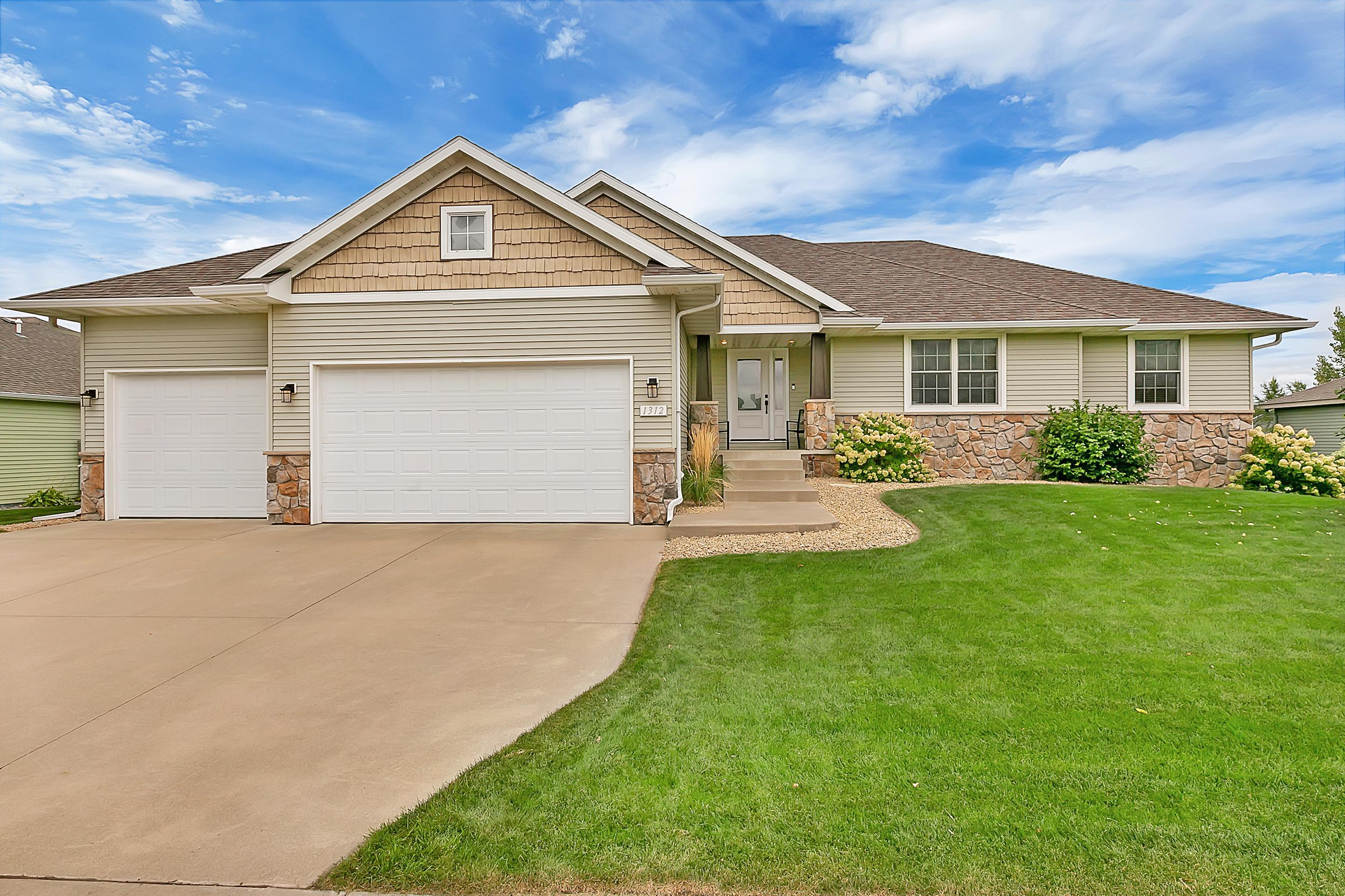 Attention to detail is evident in this immaculately maintained rambler!  Once you enter this 4 bedroom 3 bathroom home you will appreciate the many great features the home has to offer; vaulted ceilings, open floor plan, all living facilities on the main level and large windows that provide natural light galore. Kitchen has granite counter tops, tile backsplash, walk-in pantry and stainless steel appliances. Owner's suite has a tile shower and large walk-in closet. 2 additional bedrooms and a full bathroom, laundry room, informal dining room and a beautiful sunroom offering great views of the wetlands and private backyard complete the main level. The lower level has tons of space including a huge family room and fireplace as well as a large bedroom with a walk-in closet, 3/4 bathroom, potential for a 5th bedroom/flex room that has already been framed in and a huge storage room.  Steel siding, irrigation system and 3 stall garage are the finishing touches to this amazing home!