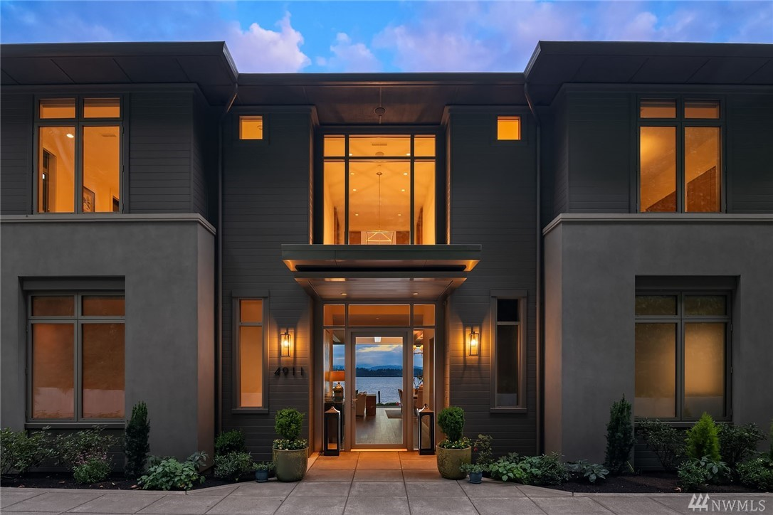 Luxe Laurelhurst residence with 145 ft of prime Lake Washington Waterfront. A 2019 Schultz Miller remodel revitalized this stunning home which embraces its endless views from nearly every room. Upon entering, the centerpiece of the home is the stunning great room with glass wall which frames the view and opens directly to the patio/lawn, only steps to the lake. Dock; boat lift; theater; elevator; gym; offices; 5 car garage; exquisite master suite. An idyllic, peaceful retreat not to be missed.