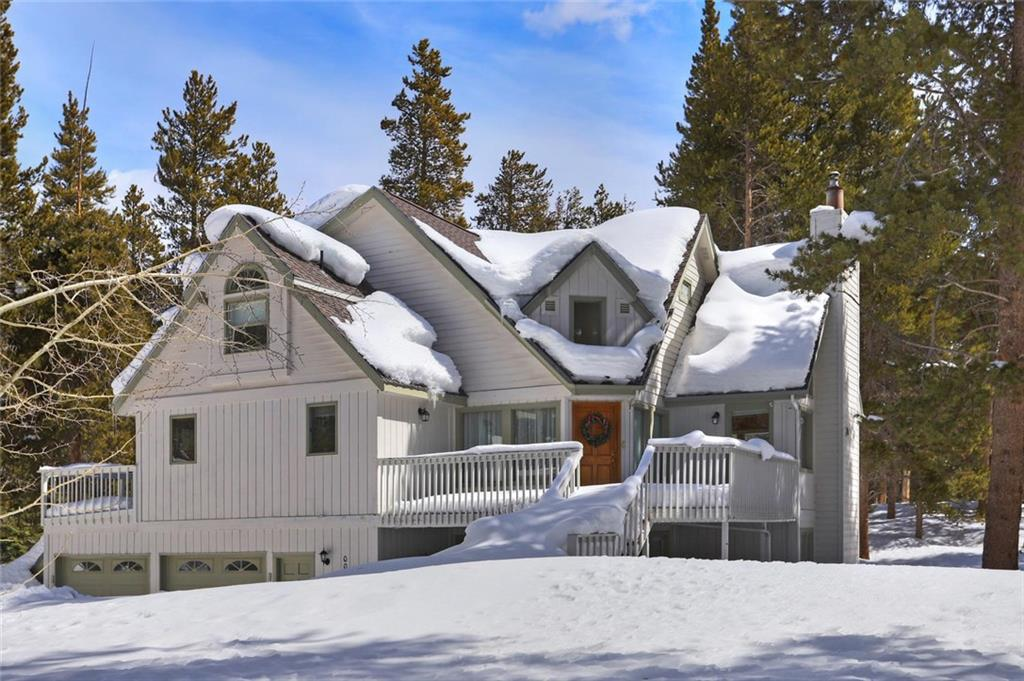 """This quintessential """"cabin in the woods"""" is less than 2 miles to Downtown Breckenridge. Gourmet kitchen complete with Bosch appliances, granite counters, double wall ovens, warming drawer and more. Private master suite on the top floor with stone fireplace, walk in closet, double sinks, stand alone shower and separate soaking tub for a blissful place to relax. Complete with vaulted ceilings, hot tub, a 2 car garage and only a short walk to the Tarn Lake make this home a must see!"""