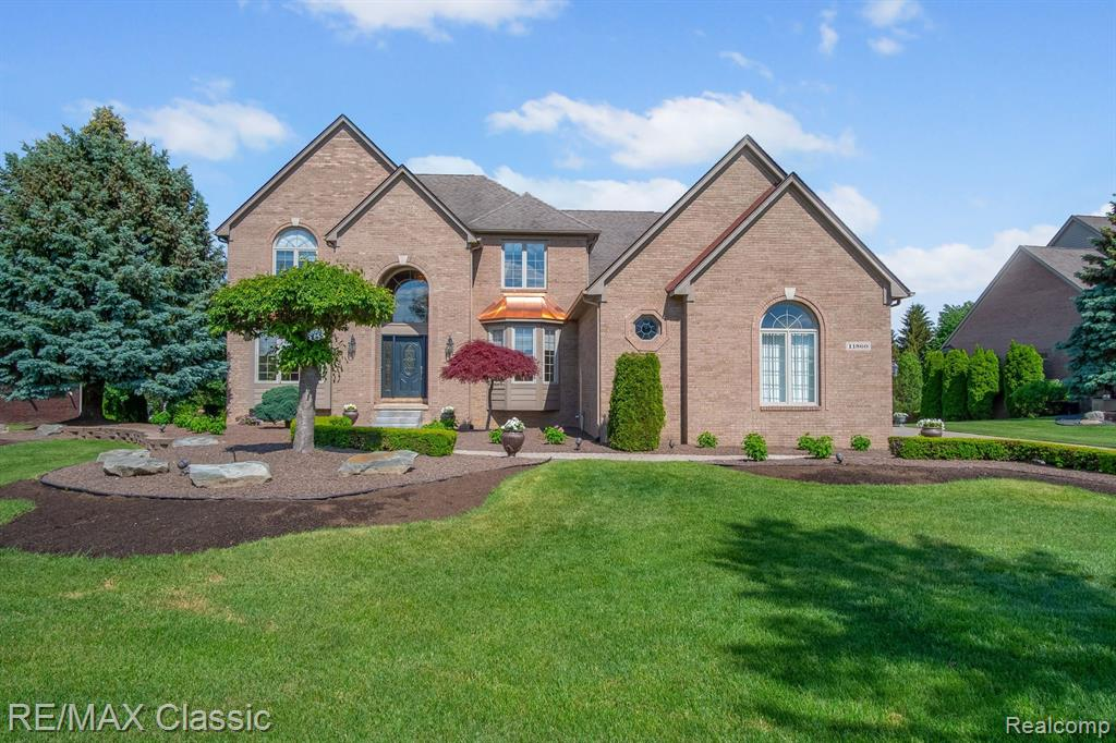 """Huntington Park .... Dynasty Built ... 4,000+ square foot Pristine Showcase Colonial ... with 4 BR's & 4.5 luxurious baths & a 2,200+ square foot above grade caliber finished walkout LL w/wood floor & direct access to the garage! Picture perfect brick exterior with brick paver driveway, substantial terrace & over an acre of lush landscaping on a private 1 acre priceless setting with basketball/volleyball court! Spectacular interior with 2 staircases + soaring ceilings & floor to ceiling windows + freshly painted beige walls accented with white trim including substantial dimensional & fluted casings + there's newer premium carpet, hardwood floors & ceramic floors ~ All 4.5 baths & the laundry rm have granite topped cabinets ~ Gourmet kitchen with white """"Yorkshire"""" cabinets & black granite topped counters, island & desk + """"Frigidaire Gallery"""" SS appliances including 2 convection ovens ~ Cathedraled master with jetted tub spa bath & huge WIC ~ 2 BR's w/shared bath + a 4th BR w/full bath."""