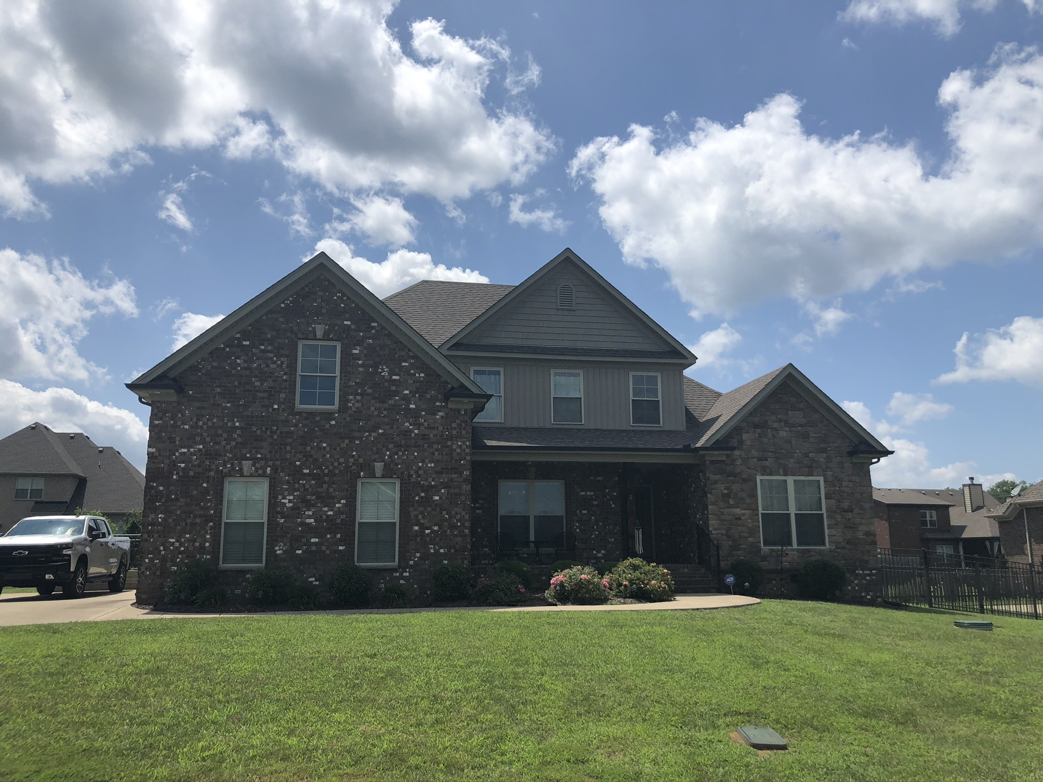 Fantastic opportunity in highly sought after SpringHouse in Murfreesboro.  4 Bedrooms 3 Full Baths with Owner's suite on main level. Home has hardwood floors thru kitchen and living room. Master bathroom is very nice with double vanities and tile shower with rain head. Home is all brick with stone.  Oversized flat backyard.