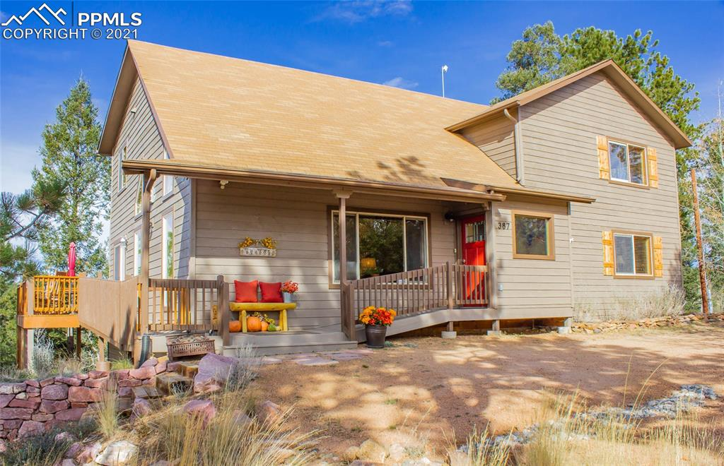 Make your mountain living dream a reality in this beautiful 4 Bedroom, 3 Bath, 4170 sq ft home that boasts views of both Pikes Peak and Sangre De Cristos. Quiet and secluded, yet only minutes to Divide on county-maintained roads. Impressive 1,100 sq ft detached Garage has plenty of room for cars, toys, workshop, and all your hobbies! New exterior paint and new roof on house being installed. This open-concept home has a bright and airy feel that is especially evident in the Great Room with dramatic vaulted ceilings, unique