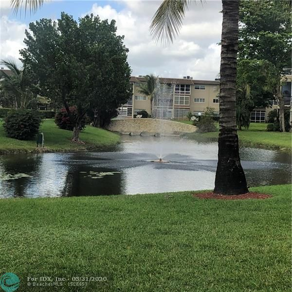 BRIGHT & CLEAN 1ST FLOOR UNIT WITH VIEWS ON LAKE- 2 BEDROOM 2 BATH COMPLETELY RENOVATED  WITH TILE AND WOOD FLOORS - WHITE APPLIANCES IN KITCHEN & GRANITE - GREAT FLORIDA ROOM WITH NEW WINDOWS & WATER VIEW- RECESS LIGHTING ON CEILINGS - UNIT IN GREAT CONDITION WITH QUALITY NEW FURNITURE - SOLD FURN. TURNKEY - GREAT LOCATION CLOSE TO CLUBHOUSE AND COMMUNITY POOL & WALKING TRAILS ON A CANAL ON THE NEXT STREET -ADULT COMMUNITY 55 + COMMUNITY OFFERS MANY AMENITIES SUCH AS POOL BBQ PICNIC AREA GYM LIBRARY SHUFFLEBOARD - VERY AFFORDABLE MAINTENANCE OF $287 A MONTH INCLUDING INTERNET -  YOU WILL NOT BE DISAPPOINTED - EASY TO SHOW - CALL REALTOR PAULINE 954-899-7967.  THANKS FOR SHOWING