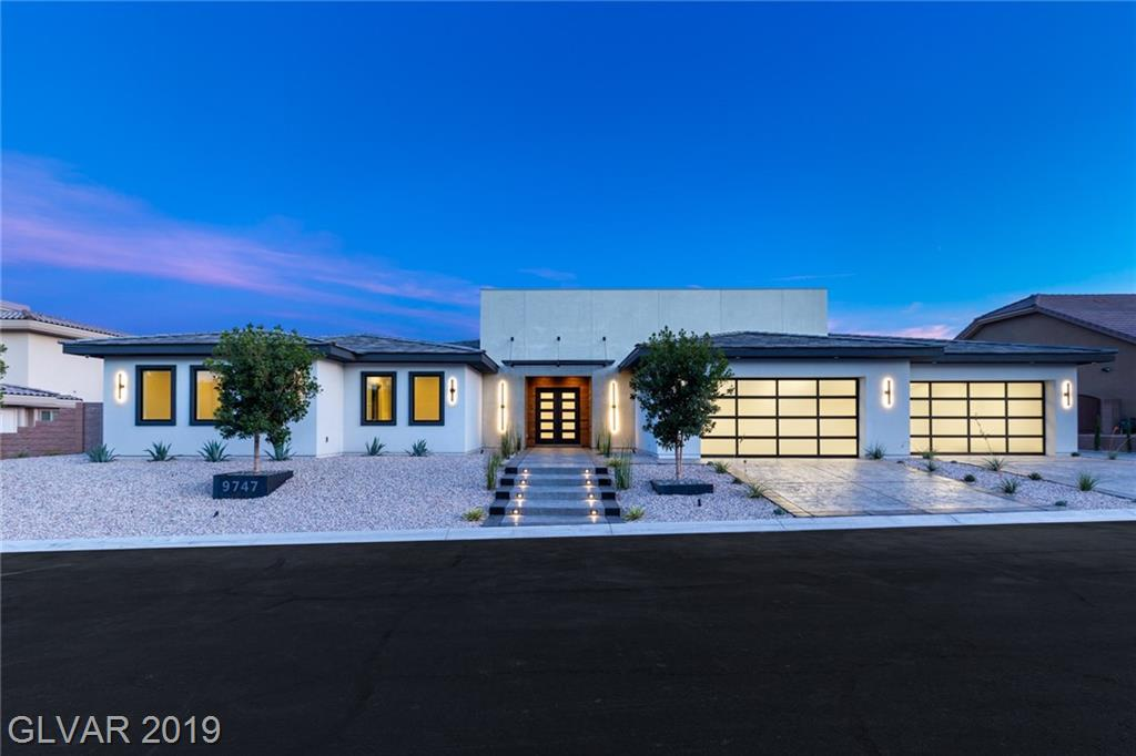 Brand New Custom Contemporary Home with Strip & Mtn Views!  Beautifully upgraded home w/attention to detail and quality finishes.  2x6 exterior framing, Marvin Custom Windows, 3-coated stucco, LED Lighting, 2 Tankless, Full wetbar, 4 car glass  garage doors, Iron Front Door, 400 AMP Elec, Interior insulation for sound proofing, AC zoned system, etc.. This home is a must see to appreciate what it has to offer!