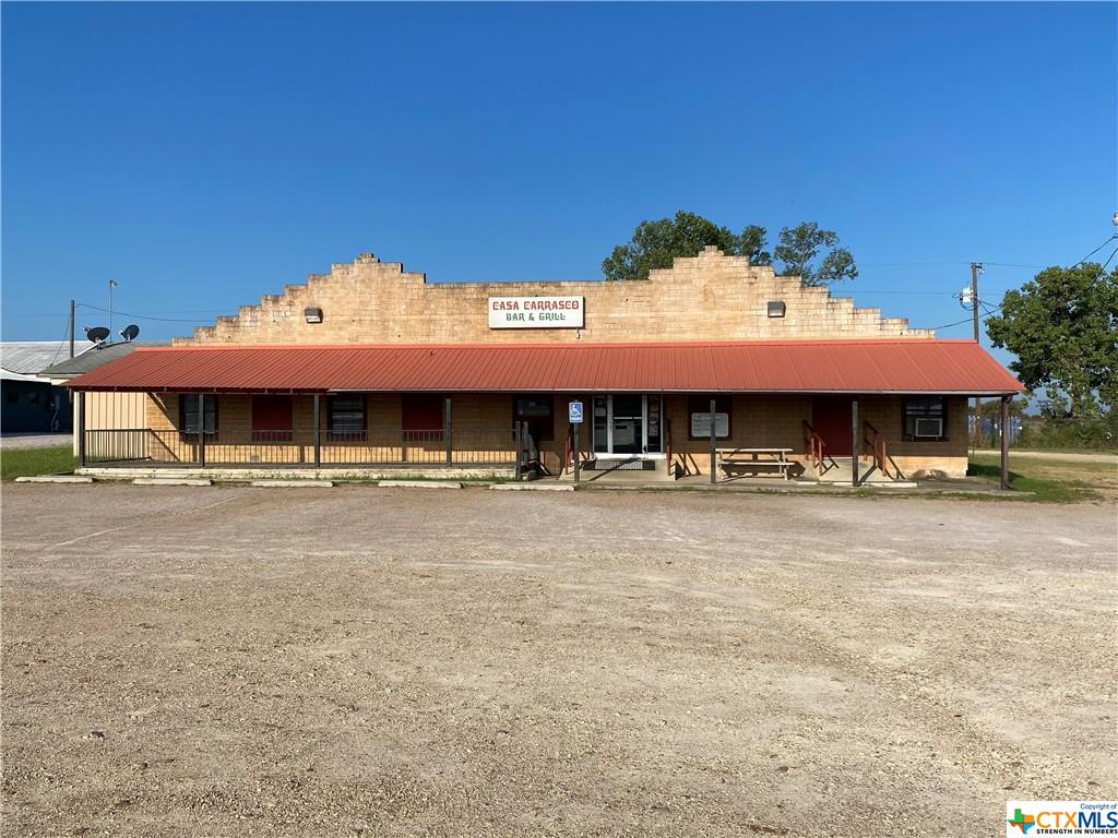 Great commercial property with frontage on US Highway 77. Currently being used as a restaurant, all owned equipment and contents convey. Tables, chairs, booths, dishes, multiple neon beer signs, pots/pans/tubs, walk in cooler/freezer...EVERYTHING conveys. (Soda and dish machine are leased) Ample parking available. Could easily be renovated into a daycare, boutique, office space...the possibilities are endless. All information and measurements to be verified by buyer.