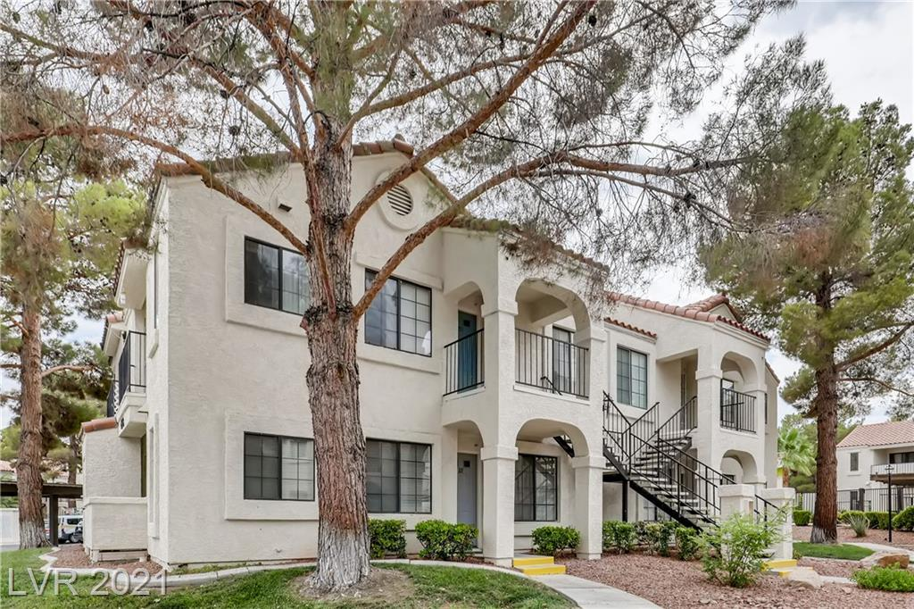 This comfortable 1 Bedroom Condo is located conveniently just off Tropicana & Rainbow Blvd in a gated community with 3 swimming pools and spas. Upgraded AC. Community Pool (small 1 time fee) & Reserved Parking is included with Ownership. Refreshed Kitchen with Gas Range, Dishwasher, Refrigerator with brand new Garbage Disposal. Spacious Living Room. All New Flooring throughout. Bedroom with Large Closet & Tub/Shower combo. Glass Sliding Door opens to a relaxing Porch area with Washer/Dryer enclosure. Quiet living in this North facing unit, provides shade during the hot summer months, this is a Great Living Space!
