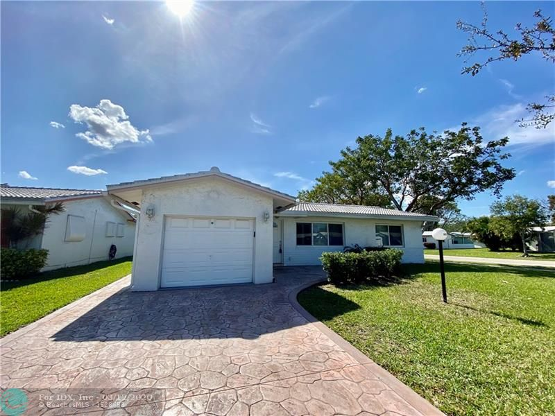 Motivated seller.  Lovely +55 community, comfortably and quiet area.  Corner home with 2 bedrooms/2 bathrooms, 1 car garage with builder's Florida room, and screened in porch.  Impacted windows, roof replaced in 2018.  HOA takes care of the roof, lawn, exterior painting.  Community provides courtesy bus, active clubhouse, 2 pools & hot tubs, tennis, shuffle board, pool tables, ping pong tables, card rooms, fitness center, entertainment & shows, and much more. Located near shopping, banks, medical services, restaurants, major highways.
