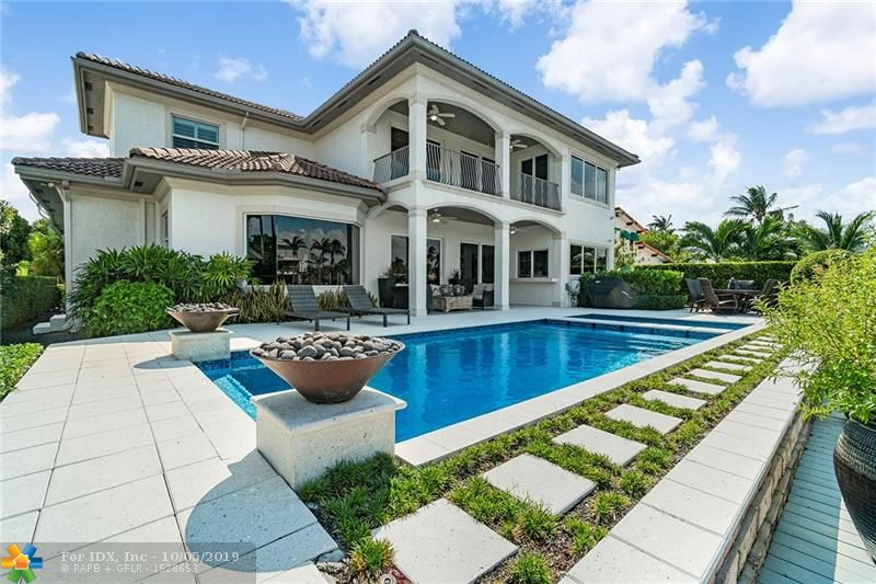 This exquisitely remodeled home features 70ft of dockage on 150ft wide canal with great views only minutes away by yacht from the inlet. The current owner recently also completed the new pool, spa, composite dock, new pool deck, and new impact windows. Downstairs features a new gourmet kitchen with Wolf gas range, dining area with a bay window, new marble floors, great room and wet bar facing the water. Guest bedroom with private bath and oversized two car garage and laundry room. A modern staircase leads to a total of three bedrooms upstairs. Gorgeous new master bath with dual vanities, separate bath and shower, beautiful master bedroom with large walk-in closet and a romantic waterside balcony. Just move in and enjoy the close proximity to shopping, downtown and the ocean.
