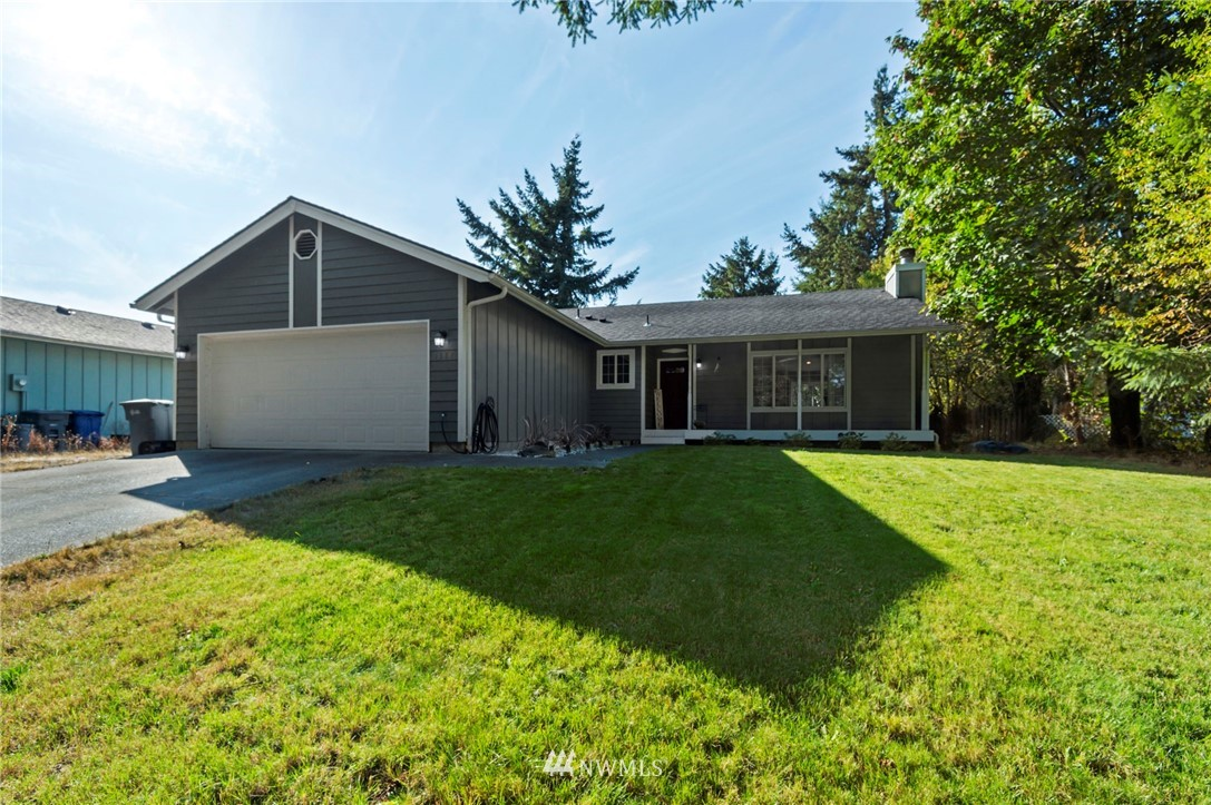 Welcome to this well appointed rambler with an open layout, vaulted ceilings, and new vinyl plank flooring throughout main living spaces. The large kitchen with stainless steel appliances and quartz countertops make this home shine. Cozy wood fireplace to keep you warm in the winter and a spacious fully fenced yard with a large wood deck to entertain year round. Primary bedroom with ensuite bathroom, newer roof, wired for generator & room to park your RV or boat.
