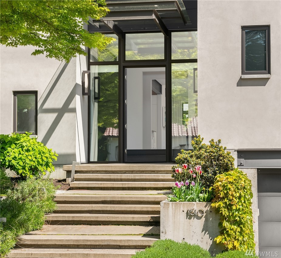 Contemporary gem situated in Seattle's Broadmoor neighborhood. Built in 2010 this Northwest Energy Star certified home was built with maximum efficiency in mind. With bold steel beams, walls of glass, dark wood floors the home feels spacious and comfortable. Each bedroom includes its own bath, while the master wing includes a spa like bath and home office. Easy inside out living with level entry from the great room to the private, back yard. Rec room, solar panels, bonus room, a 2 car garage.