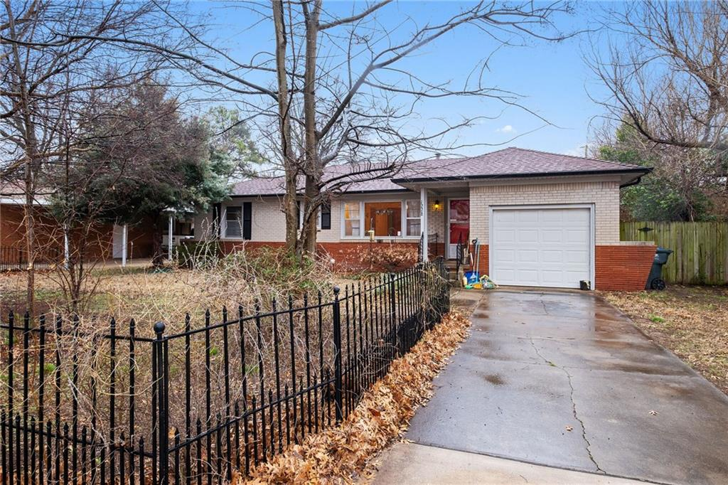 This traditional 1952 property is quite charming. Situated in a well-established, tree-lined Norman neighborhood it has a single, attached garage and large, fenced lawns in front and back. Ceiling fans in all rooms with wood floors throughout (tile in bathroom/vinyl in kitchen). Added insulation in loft space (2014), new roof/exterior screens/gutters & down spouts (2012), new water heater and kitchen floor (2019). Economical to heat/cool throughout the year. Walking distance to elementary, middle, and high schools, the property is 1.25 miles from the University of Oklahoma. Parks, playgrounds, tennis courts, shopping areas, and entertainment are all within 0-2 miles.