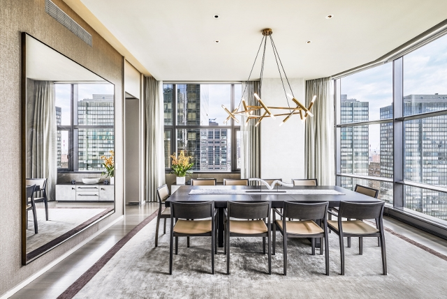 """Immediate delivery. An impressive 3 Bedroom, 3.5 Bath, half-floor condominium with open exposures to the east, north and west and ceiling heights over 11'. A 13'x10'6"""" Foyer leads to a Living and Dining area nearly fifty feet in length featuring two Foster + Partner designed floor-to-ceiling bay windows overlooking the East River and United Nations. From the north exposure of the Dining Area there are also exceptional city views. A large windowed kitchen features a center island, breakfast bar, white lacquer cabinetry by Varenna, honed absolute black granite countertops, and top of the line appliances by Miele and Sub-Zero. The Manhattan skyline provides a cinematic backdrop to the spacious Master Bedroom. The Master Bath features Sivec white marble and teak finishes and is outfitted with a Kohler Ironworks soaking tub, stall shower. Bedrooms 2 and 3 have open views and well appointed en-suite baths. There is also a striking Powder Room with a custom designed Corian basin and slab marble floors. The ultimate global address, 50 United Nations Plaza is an 88 unit full-service condominium with Resident Manager, 24 Hour Concierge, Doorman and Porters. Amenities include gated landscaped motor court, valet parking and on-site parking available for purchase. Managed by the Wright Fit, the Fitness Center features a 75 foot swimming pool, sauna, steam and massage rooms and a state of the art gym. In addition there is a Conference Room and Children's Playroom. Wine cellars and additional storage units are available for purchase. A Sponsor funded carrying cost subsidy is in place until June 2022 making for attractive monthly charges."""