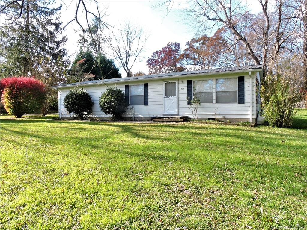Great Starter Home or Investment Property! Well Maintained Doublewide on .37 level acres just minutes from shopping, restaurants, and I-26. This home features 3 BR, 2 Full Baths, large living room, dining area and large kitchen. The home has a newer metal roof and large attached carport for parking. Shared driveway. Sold As-Is.