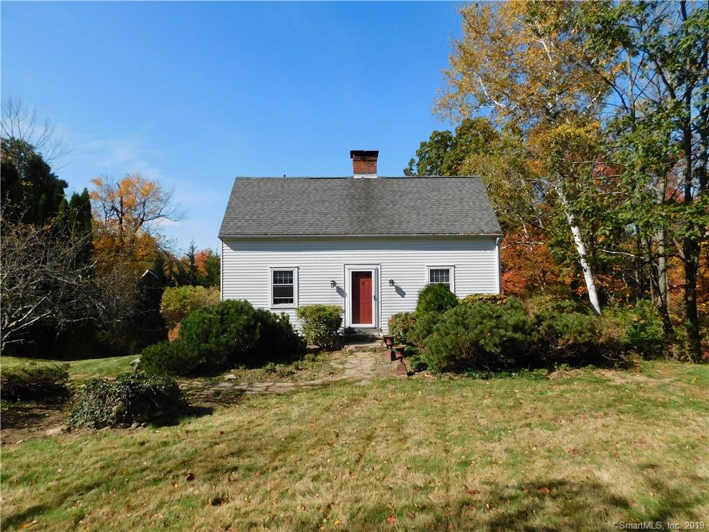 Horse Property! 3.13 acres, R4A zone, 5 10x12 stall barn with fenced ring area.  A gem not to be missed...  This Saltbox, 3BR, 2 full baths, 4 zone heat, skylights, hardwood floors on 1st floor just refinished, new carpet in bedrooms.  Step out of the eat-in kitchen area onto your oversized deck that overlooks a picturesque view.  The home is wired w/generator, 200amp service, newer oil tank, underground tank has been removed.  Fully finished walkout basement with family room, workout room, walk-in closet and pantry for extra storage.  This property gives you a feeling of privacy but you are close to shopping, Bradley International Airport and major routes to get where you need to easily.  Book your showings today!