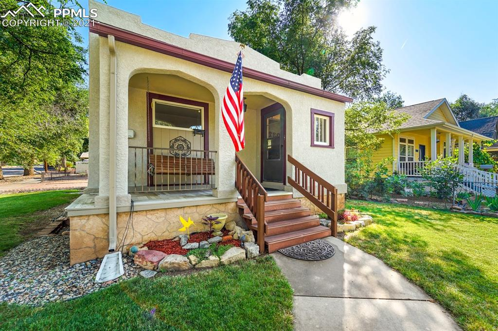 Exceptional location! This rare & charming 4 bed, 2 bath RANCH home sits on a corner lot on the west side. It features a spacious kitchen, a brick wood burning fireplace, built-in cabinets in living room, newer carpet in the lower level, a large covered porch with swing, a fully landscaped yard and detached mini garage/storage. The home is close to downtown Old Colorado City, parks, restaurants and museums. Don't miss out on making this your home sweet home!